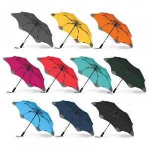 multicolour blunt metro classic umbrella with a moulded plastic hand grip and woven wrist strap