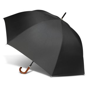 black umbrella with a classic wood hook handle and variances in the grain pattern