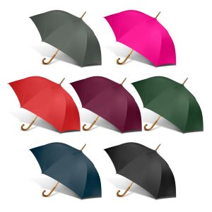 selection of multicolour peros boutique umbrella with a natural wood hook handle and variances in the grain pattern